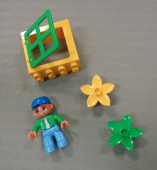 unusual lego blocks - a person, flowers, a window